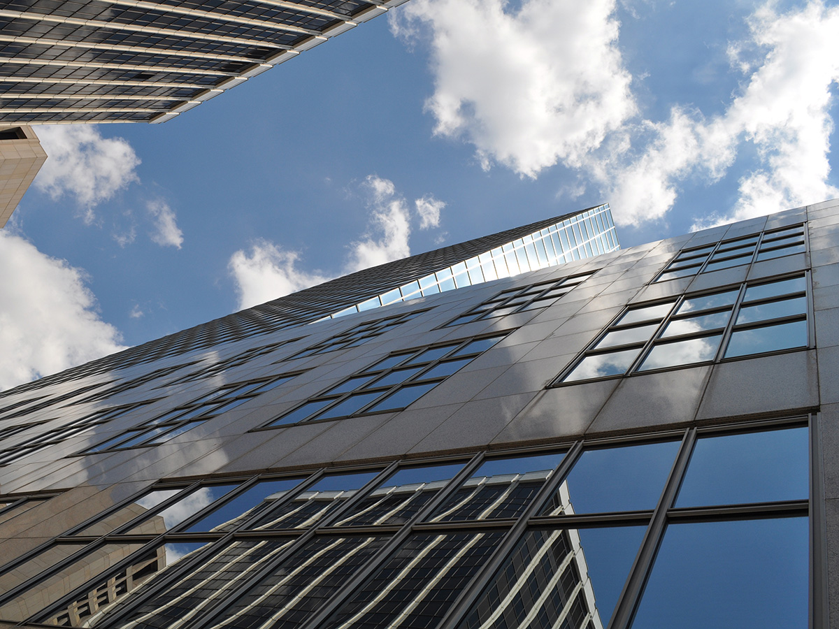 Glass building windows looking up to the sky