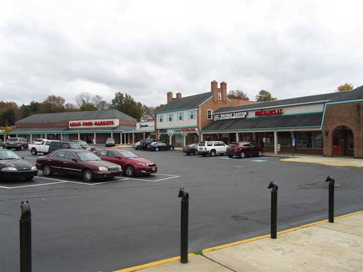 Buildings and parking lot in the Barclay Farms shopping center