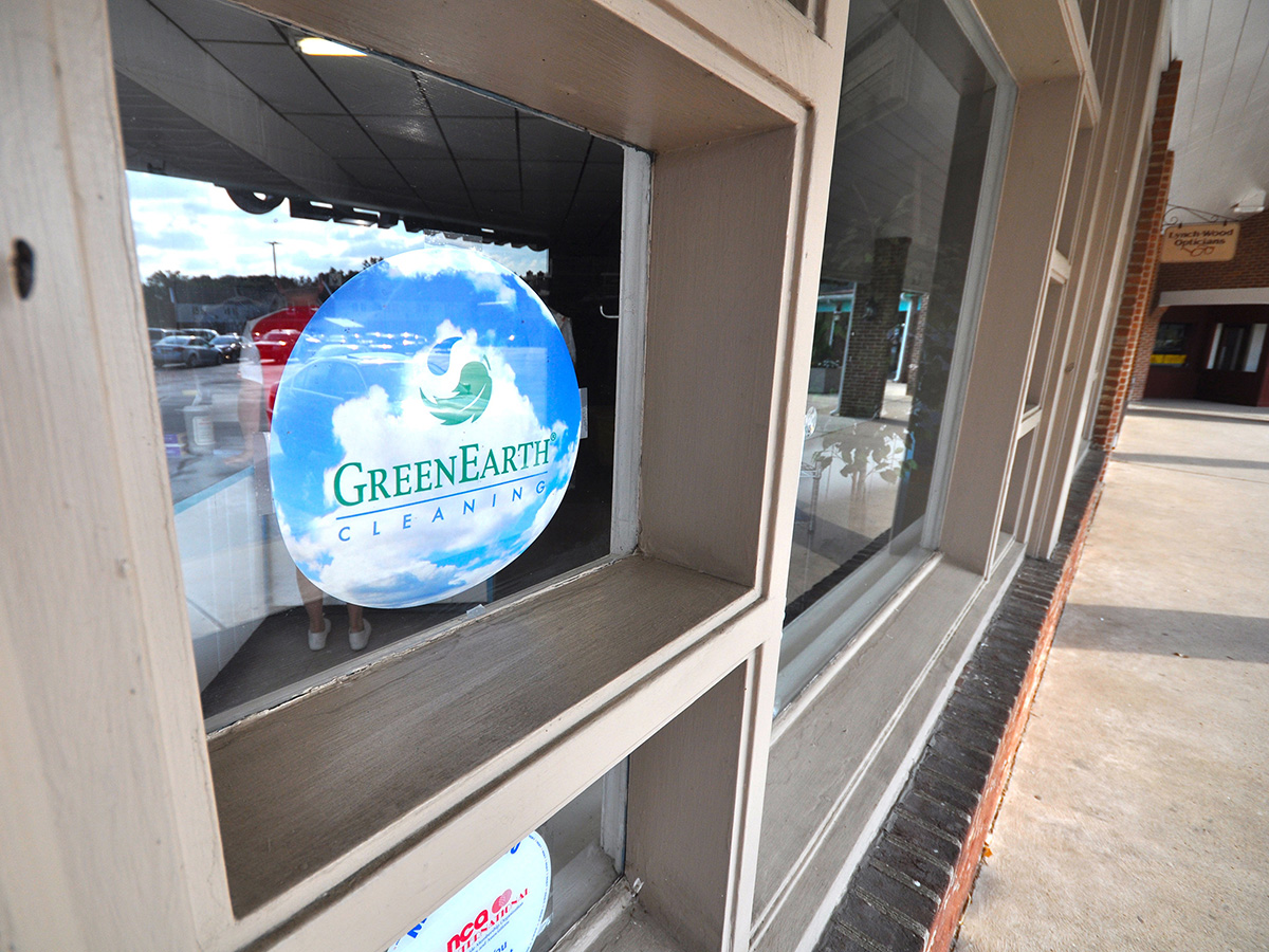Green Earth Cleaners window with logo