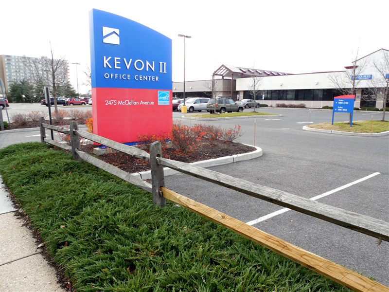 Sign and parking lot for Kevon 2 office center with building in background