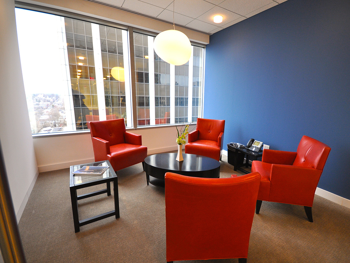 Small meeting room with red chairs and a table